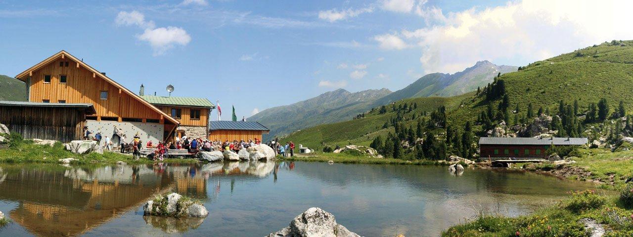 Ziel der 8. Etappe: die Lizumer Hütte, © Alpenverein Hall in Tirol/Lizumer Hütte