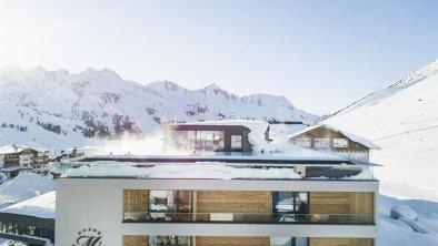 Hotel Mooshaus mit Bergpanorama