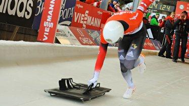 Spannend vom Start bis zum Ziel: Ein Skeletonfahrer wird beim Weltcup angefeuert, © ÖBSV
