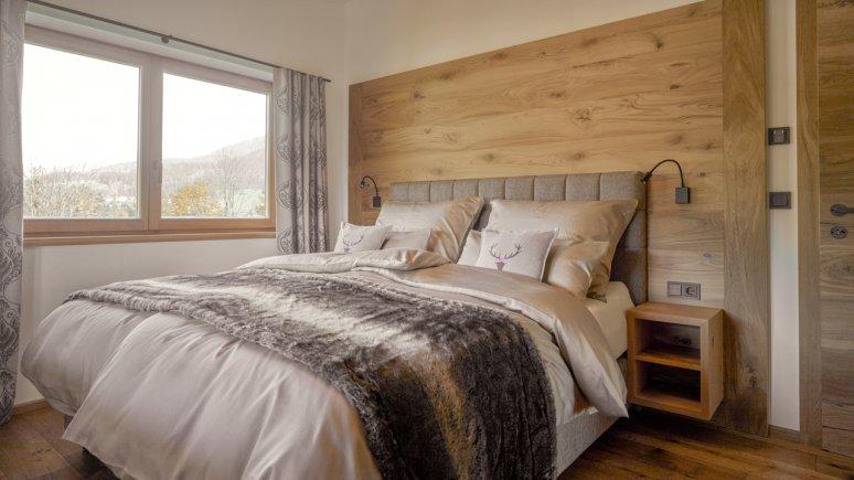 Schlafzimmer in den Chalets Grosslehen, © Toni Niederwieser