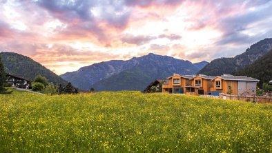 Außenansicht mit Abendrot Alpegg Chalets Waidring
